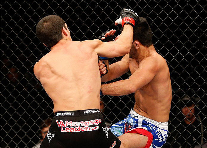 BELO HORIZONTE, BRAZIL - SEPTEMBER 04:  (L-R) Joseph Benavidez knocks down Jussier Formiga with a punch in the flyweight fight during the UFC on FOX Sports 1 event at Mineirinho Arena on September 4, 2013 in Belo Horizonte, Brazil. (Photo by Josh Hedges/Z