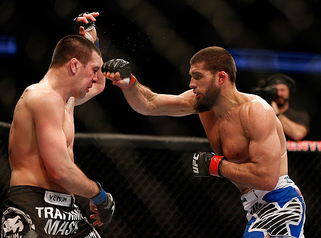 ANAHEIM, CA - FEBRUARY 23:  (R-L) Court McGee punches Josh Neer in their welterweight bout during UFC 157 at Honda Center on February 23, 2013 in Anaheim, California.  (Photo by Josh Hedges/Zuffa LLC/Zuffa LLC via Getty Images) *** Local Caption *** Court