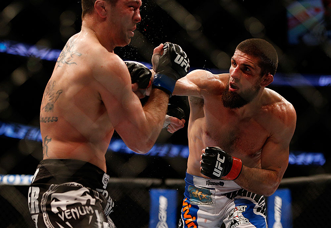 ANAHEIM, CA - FEBRUARY 23:  (R-L) Josh Neer punches Court McGee in their welterweight bout during UFC 157 at Honda Center on February 23, 2013 in Anaheim, California.  (Photo by Josh Hedges/Zuffa LLC/Zuffa LLC via Getty Images) *** Local Caption *** Court