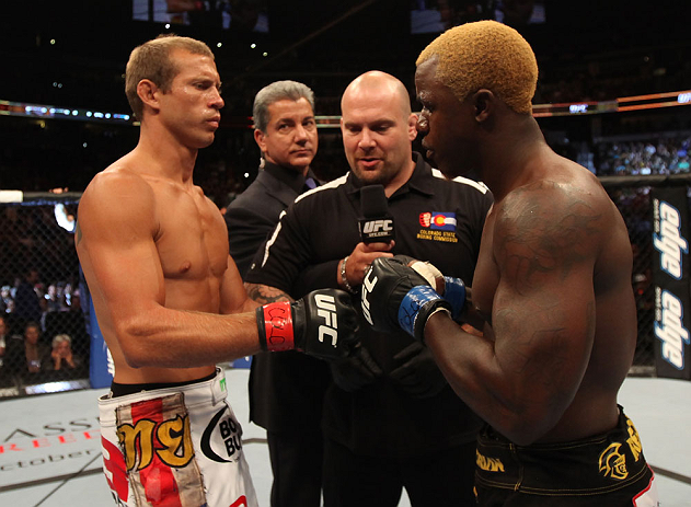 """DENVER, CO - AUGUST 11:  (L-R) Donald """"Cowboy"""" Cerrone and Melvin Guillard receive final instructions from the referee before their lightweight bout at UFC 150 inside Pepsi Center on August 11, 2012 in Denver, Colorado. (Photo by Nick Laham/Zuffa LLC/Zuff"""