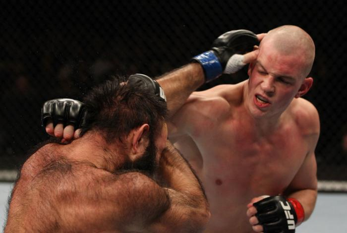 OMAHA, NE - FEBRUARY 15:  (R-L) Stefan Struve punches Dave Herman during the UFC on FUEL TV event at Omaha Civic Auditorium on February 15, 2012 in Omaha, Nebraska.  (Photo by Josh Hedges/Zuffa LLC/Zuffa LLC via Getty Images) *** Local Caption *** Stefan