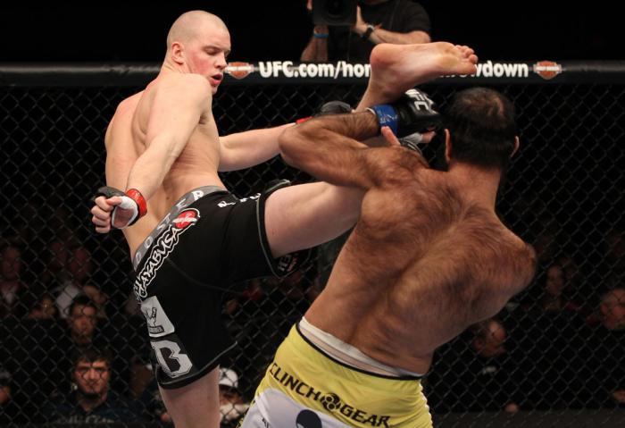 OMAHA, NE - FEBRUARY 15:  (L-R) Stefan Struve kicks Dave Herman during the UFC on FUEL TV event at Omaha Civic Auditorium on February 15, 2012 in Omaha, Nebraska.  (Photo by Josh Hedges/Zuffa LLC/Zuffa LLC via Getty Images) *** Local Caption *** Stefan St