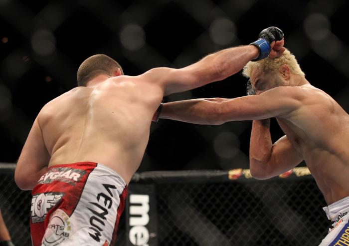 LAS VEGAS, NV - FEBRUARY 04:  (L-R) Mike Pierce and Josh Koscheck exchange punches during the UFC 143 event at Mandalay Bay Events Center on February 4, 2012 in Las Vegas, Nevada.  (Photo by Josh Hedges/Zuffa LLC/Zuffa LLC via Getty Images) *** Local Capt