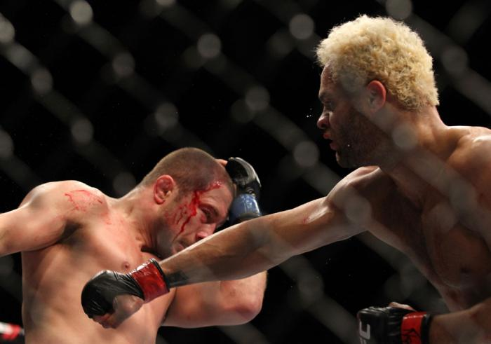 LAS VEGAS, NV - FEBRUARY 04:  Josh Koscheck (right) punches Mike Pierce during the UFC 143 event at Mandalay Bay Events Center on February 4, 2012 in Las Vegas, Nevada.  (Photo by Josh Hedges/Zuffa LLC/Zuffa LLC via Getty Images) *** Local Caption *** Jos