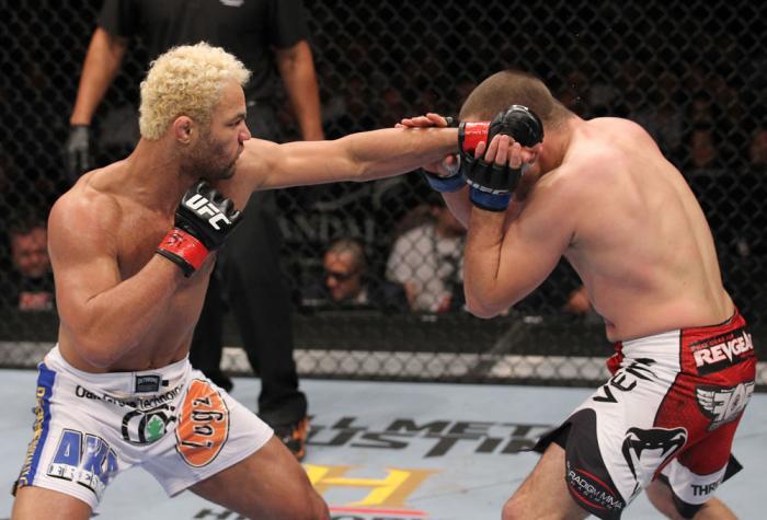 LAS VEGAS, NV - FEBRUARY 04:  Josh Koscheck (left) punches Mike Pierce during the UFC 143 event at Mandalay Bay Events Center on February 4, 2012 in Las Vegas, Nevada.  (Photo by Nick Laham/Zuffa LLC/Zuffa LLC via Getty Images) *** Local Caption *** Josh