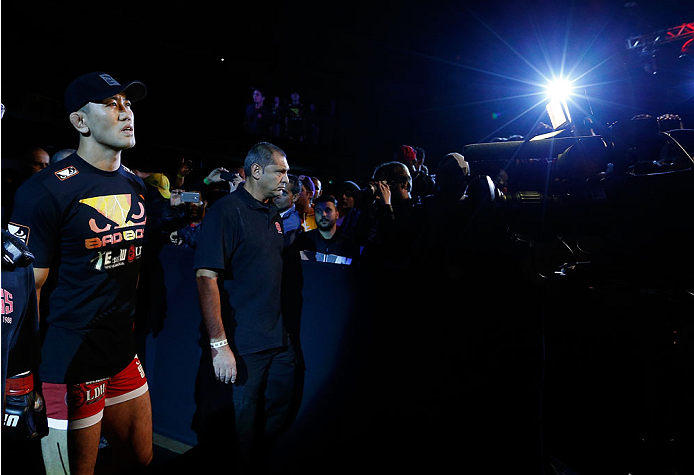 """BELO HORIZONTE, BRAZIL - SEPTEMBER 04:  Yushin Okami enters the arena before his middleweight fight against Ronaldo """"Jacare"""" Souza during the UFC on FOX Sports 1 event at Mineirinho Arena on September 4, 2013 in Belo Horizonte, Brazil. (Photo by Josh Hedg"""
