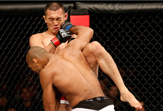 """BELO HORIZONTE, BRAZIL - SEPTEMBER 04:  (L-R) Ronaldo """"Jacare"""" Souza knocks out Yushin Okami with a punch in their middleweight fight during the UFC on FOX Sports 1 event at Mineirinho Arena on September 4, 2013 in Belo Horizonte, Brazil. (Photo by Josh H"""