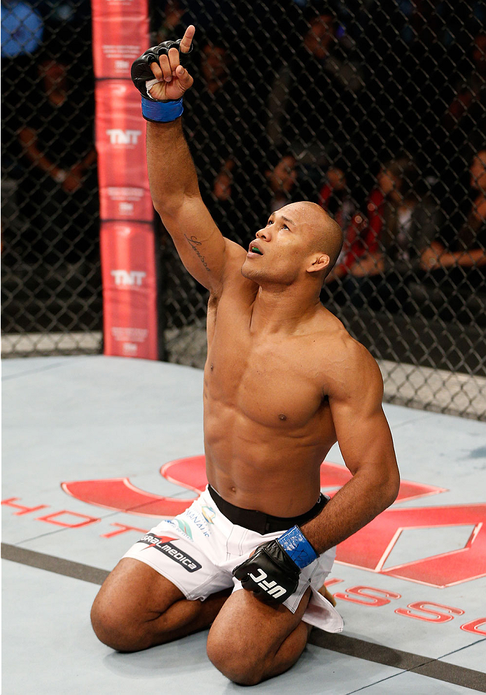 """BELO HORIZONTE, BRAZIL - SEPTEMBER 04:  Ronaldo """"Jacare"""" Souza reacts after knocking out Yushin Okami in their middleweight fight during the UFC on FOX Sports 1 event at Mineirinho Arena on September 4, 2013 in Belo Horizonte, Brazil. (Photo by Josh Hedge"""