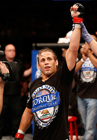 ANAHEIM, CA - FEBRUARY 23:  Urijah Faber is declared the winner over Ivan Menjivar in their bantamweight bout during UFC 157 at Honda Center on February 23, 2013 in Anaheim, California.  (Photo by Josh Hedges/Zuffa LLC/Zuffa LLC via Getty Images) *** Loca