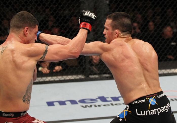 OMAHA, NE - FEBRUARY 15:  (R-L) Jake Ellenberger punches Diego Sanchez during the UFC on FUEL TV event at Omaha Civic Auditorium on February 15, 2012 in Omaha, Nebraska.  (Photo by Josh Hedges/Zuffa LLC/Zuffa LLC via Getty Images) *** Local Caption *** Ja