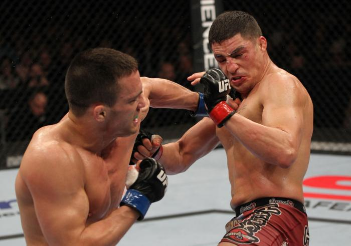 OMAHA, NE - FEBRUARY 15:  (L-R) Jake Ellenberger punches Diego Sanchez during the UFC on FUEL TV event at Omaha Civic Auditorium on February 15, 2012 in Omaha, Nebraska.  (Photo by Josh Hedges/Zuffa LLC/Zuffa LLC via Getty Images) *** Local Caption *** Ja