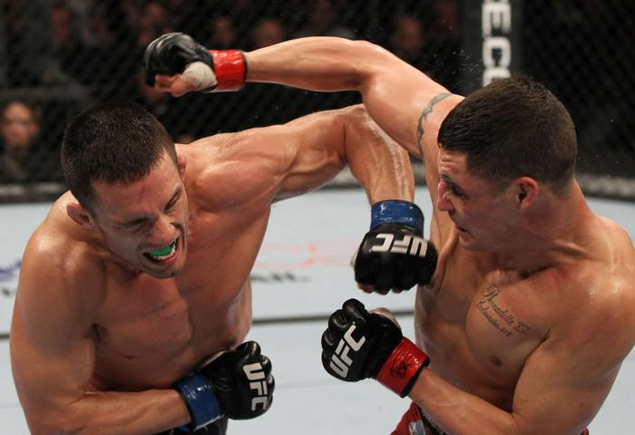 OMAHA, NE - FEBRUARY 15:  (L-R) Jake Ellenberger and Diego Sanchez trade punches during the UFC on FUEL TV event at Omaha Civic Auditorium on February 15, 2012 in Omaha, Nebraska.  (Photo by Josh Hedges/Zuffa LLC/Zuffa LLC via Getty Images) *** Local Capt
