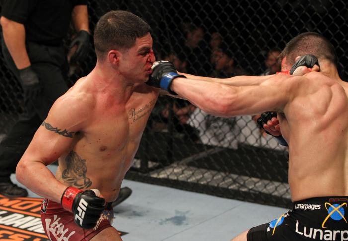 OMAHA, NE - FEBRUARY 15:  (L-R) Diego Sanchez and Jake Ellenberger trade punches during the UFC on FUEL TV event at Omaha Civic Auditorium on February 15, 2012 in Omaha, Nebraska.  (Photo by Josh Hedges/Zuffa LLC/Zuffa LLC via Getty Images) *** Local Capt