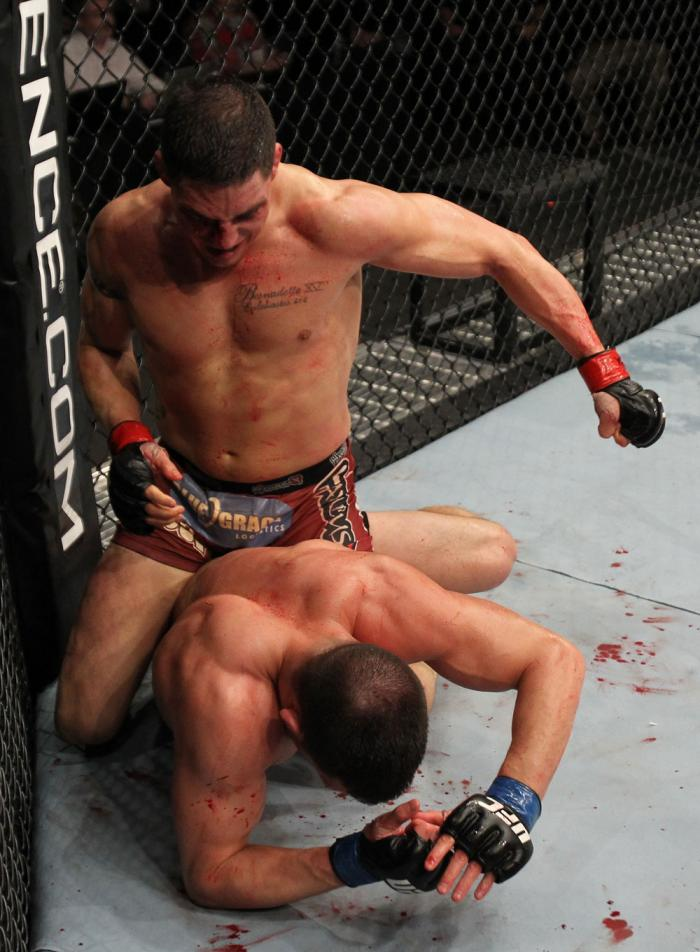 OMAHA, NE - FEBRUARY 15:  (L-R) Diego Sanchez punches Jake Ellenberger during the UFC on FUEL TV event at Omaha Civic Auditorium on February 15, 2012 in Omaha, Nebraska.  (Photo by Josh Hedges/Zuffa LLC/Zuffa LLC via Getty Images) *** Local Caption *** Ja