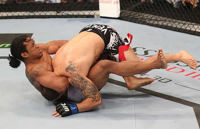 DENVER, CO - AUGUST 11:  (R-L) Benson Henderson attempts a guillotine choke submission against Frankie Edgar during their lightweight championship bout at UFC 150 inside Pepsi Center on August 11, 2012 in Denver, Colorado. (Photo by Nick Laham/Zuffa LLC/Z