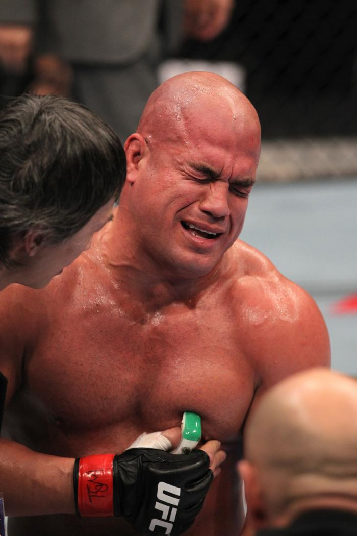TORONTO, ON - DECEMBER 10:  Tito Ortiz exhibits the pain of a blow to the ribs after his TKO loss to Antonio Rogerio Nogueira during the UFC 140 event at Air Canada Centre on December 10, 2011 in Toronto, Ontario, Canada.  (Photo by Nick Laham/Zuffa LLC/Z