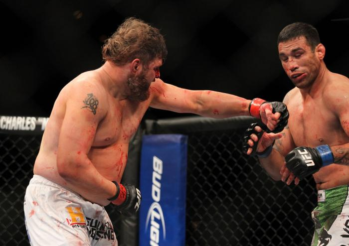 LAS VEGAS, NV - FEBRUARY 04:  Roy Nelson (left) punches Fabricio Werdum during the UFC 143 event at Mandalay Bay Events Center on February 4, 2012 in Las Vegas, Nevada.  (Photo by Josh Hedges/Zuffa LLC/Zuffa LLC via Getty Images) *** Local Caption *** Roy