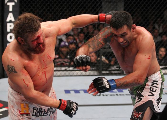 LAS VEGAS, NV - FEBRUARY 04:  (L-R) Roy Nelson punches Fabricio Werdum during the UFC 143 event at Mandalay Bay Events Center on February 4, 2012 in Las Vegas, Nevada.  (Photo by Nick Laham/Zuffa LLC/Zuffa LLC via Getty Images) *** Local Caption *** Roy N