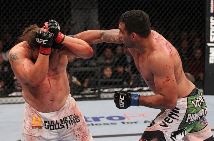 LAS VEGAS, NV - FEBRUARY 04:  (R-L) Fabricio Werdum punches Roy Nelson during the UFC 143 event at Mandalay Bay Events Center on February 4, 2012 in Las Vegas, Nevada.  (Photo by Nick Laham/Zuffa LLC/Zuffa LLC via Getty Images) *** Local Caption *** Fabri