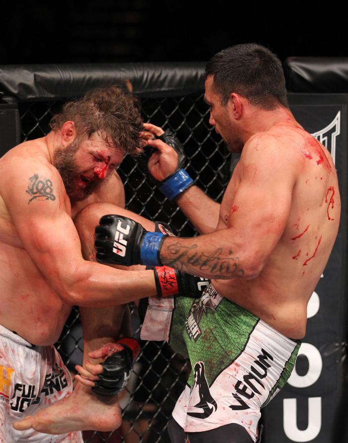 LAS VEGAS, NV - FEBRUARY 04:  Fabricio Werdum (left) knees Roy Nelson during the UFC 143 event at Mandalay Bay Events Center on February 4, 2012 in Las Vegas, Nevada.  (Photo by Nick Laham/Zuffa LLC/Zuffa LLC via Getty Images) *** Local Caption *** Fabric