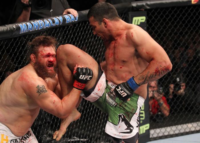 LAS VEGAS, NV - FEBRUARY 04:  Fabricio Werdum (right) knees Roy Nelson during the UFC 143 event at Mandalay Bay Events Center on February 4, 2012 in Las Vegas, Nevada.  (Photo by Nick Laham/Zuffa LLC/Zuffa LLC via Getty Images) *** Local Caption *** Fabri