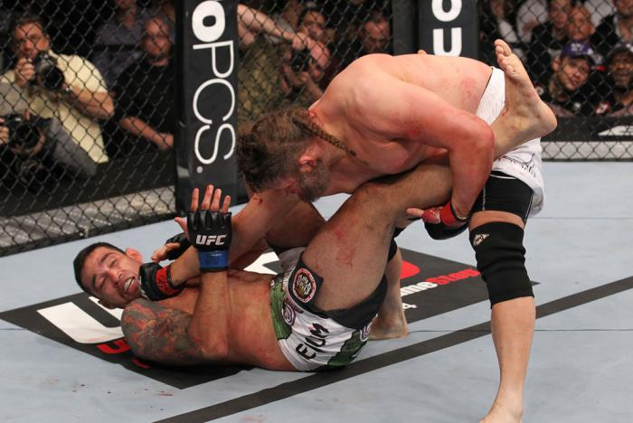 LAS VEGAS, NV - FEBRUARY 04:  Roy Nelson (right) punches Fabricio Werdum during the UFC 143 event at Mandalay Bay Events Center on February 4, 2012 in Las Vegas, Nevada.  (Photo by Nick Laham/Zuffa LLC/Zuffa LLC via Getty Images) *** Local Caption *** Roy