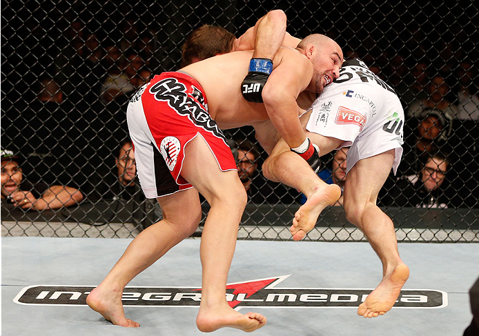 BELO HORIZONTE, BRAZIL - SEPTEMBER 04:  (L-R) Glover Teixeira takes down Ryan Bader in their light heavyweight fight during the UFC on FOX Sports 1 event at Mineirinho Arena on September 4, 2013 in Belo Horizonte, Brazil. (Photo by Josh Hedges/Zuffa LLC/Z