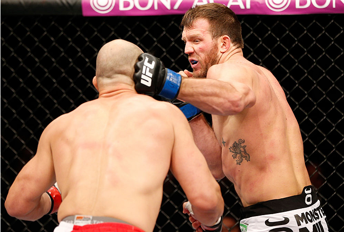BELO HORIZONTE, BRAZIL - SEPTEMBER 04:  (R-L) Ryan Bader punches Glover Teixeira in their light heavyweight fight during the UFC on FOX Sports 1 event at Mineirinho Arena on September 4, 2013 in Belo Horizonte, Brazil. (Photo by Josh Hedges/Zuffa LLC/Zuff