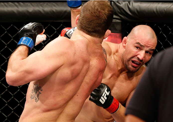 BELO HORIZONTE, BRAZIL - SEPTEMBER 04:  (R-L) Glover Teixeira knocks down Ryan Bader with a punch in their light heavyweight fight during the UFC on FOX Sports 1 event at Mineirinho Arena on September 4, 2013 in Belo Horizonte, Brazil. (Photo by Josh Hedg