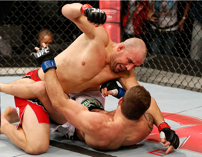 BELO HORIZONTE, BRAZIL - SEPTEMBER 04:  (L-R) Glover Teixeira punches Ryan Bader in their light heavyweight fight during the UFC on FOX Sports 1 event at Mineirinho Arena on September 4, 2013 in Belo Horizonte, Brazil. (Photo by Josh Hedges/Zuffa LLC/Zuff
