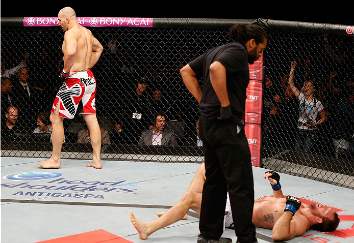 BELO HORIZONTE, BRAZIL - SEPTEMBER 04:  Glover Teixeira (L) reacts after knocking out Ryan Bader in their light heavyweight fight during the UFC on FOX Sports 1 event at Mineirinho Arena on September 4, 2013 in Belo Horizonte, Brazil. (Photo by Josh Hedge