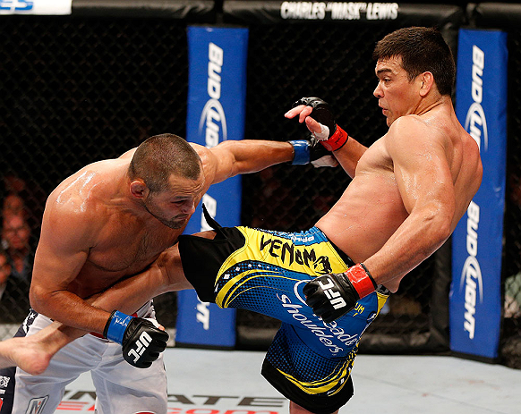 ANAHEIM, CA - FEBRUARY 23:  (R-L) Lyoto Machida kicks Dan Henderson in their light heavyweight bout during UFC 157 at Honda Center on February 23, 2013 in Anaheim, California.  (Photo by Josh Hedges/Zuffa LLC/Zuffa LLC via Getty Images) *** Local Caption
