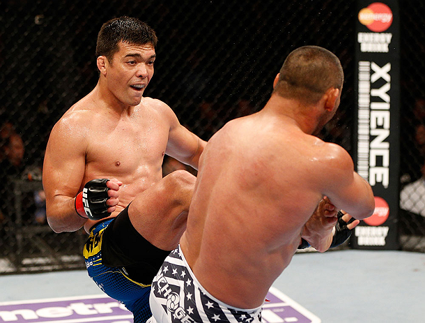 ANAHEIM, CA - FEBRUARY 23:  (L-R) Lyoto Machida kicks Dan Henderson in their light heavyweight bout during UFC 157 at Honda Center on February 23, 2013 in Anaheim, California.  (Photo by Josh Hedges/Zuffa LLC/Zuffa LLC via Getty Images) *** Local Caption