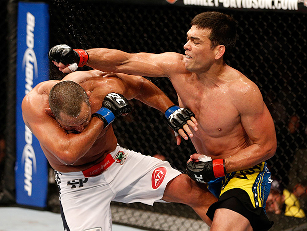 ANAHEIM, CA - FEBRUARY 23:  (R-L) Lyoto Machida punches Dan Henderson in their light heavyweight bout during UFC 157 at Honda Center on February 23, 2013 in Anaheim, California.  (Photo by Josh Hedges/Zuffa LLC/Zuffa LLC via Getty Images) *** Local Captio