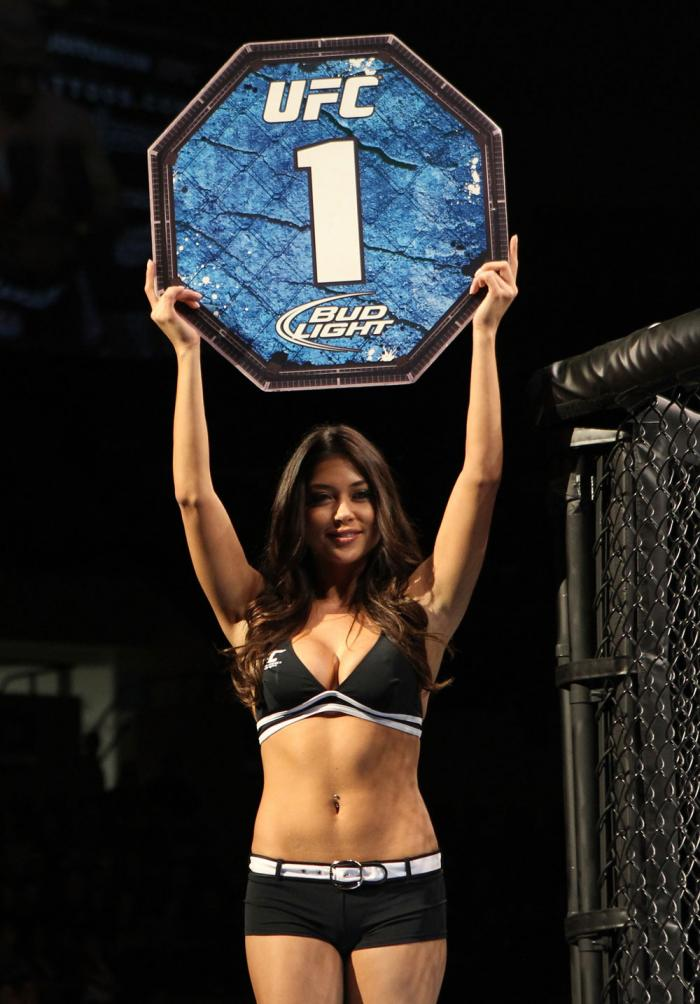 OMAHA, NE - FEBRUARY 15:  UFC Octagon Girl Brittney Palmer introduces round one before the Menjivar v Albert bout during the UFC on FUEL TV event at Omaha Civic Auditorium on February 15, 2012 in Omaha, Nebraska.  (Photo by Josh Hedges/Zuffa LLC/Zuffa LLC