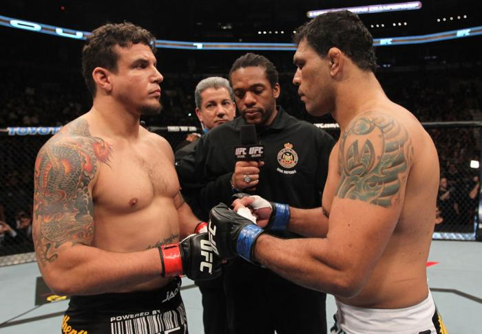 TORONTO, ON - DECEMBER 10:  (L-R) Heavyweight opponents Frank Mir and Antonio Rodrigo Nogueira receive final instructions from referee Herb Dean before their bout during the UFC 140 event at Air Canada Centre on December 10, 2011 in Toronto, Ontario, Cana