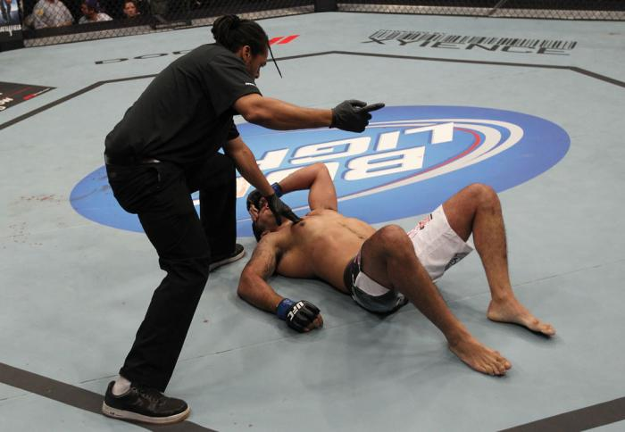 TORONTO, ON - DECEMBER 10:  (L-R) Referee Herb Dean calls for a doctor after Antonio Rodrigo Nogueira suffered a separated shoulder from an arm lock against Frank Mir during the UFC 140 event at Air Canada Centre on December 10, 2011 in Toronto, Ontario,