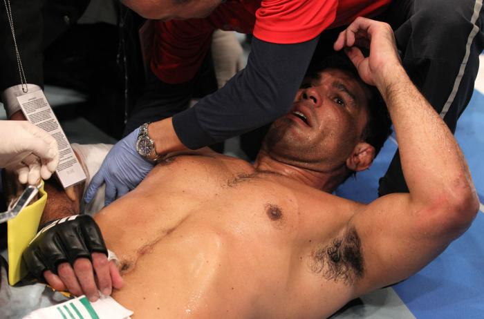 TORONTO, ON - DECEMBER 10:  Antonio Rodrigo Nogueira receives treatment from the doctors after suffering a separated shoulder against Frank Mir during the UFC 140 event at Air Canada Centre on December 10, 2011 in Toronto, Ontario, Canada.  (Photo by Nick