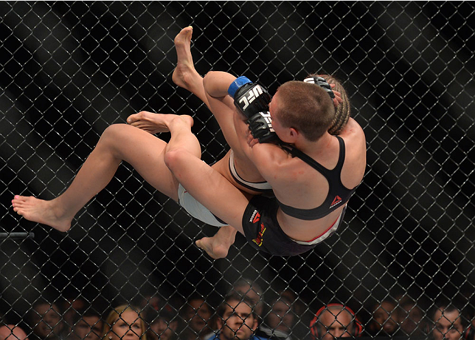 LAS VEGAS, NEVADA - DECEMBER 10:  Rose Namajunas takes down and attempts a submission on Paige VanZant in their women's strawweight bout during the UFC Fight Night event at The Chelsea at the Cosmopolitan of Las Vegas on December 10, 2015 in Las Vegas, Ne