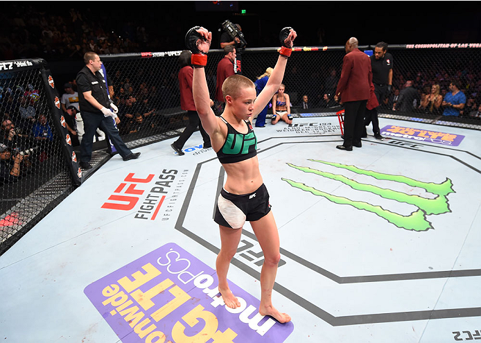 LAS VEGAS, NEVADA - DECEMBER 10:  Rose Namajunas celebrates her submission victory over Paige VanZant in their women's strawweight bout during the UFC Fight Night event at The Chelsea at the Cosmopolitan of Las Vegas on December 10, 2015 in Las Vegas, Nev