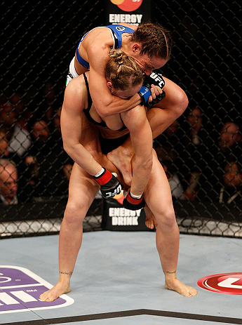 ANAHEIM, CA - FEBRUARY 23:  Liz Carmouche (top) attempts to submit Ronda Rousey in their women's bantamweight title fight during UFC 157 at Honda Center on February 23, 2013 in Anaheim, California.  (Photo by Josh Hedges/Zuffa LLC/Zuffa LLC via Getty Imag