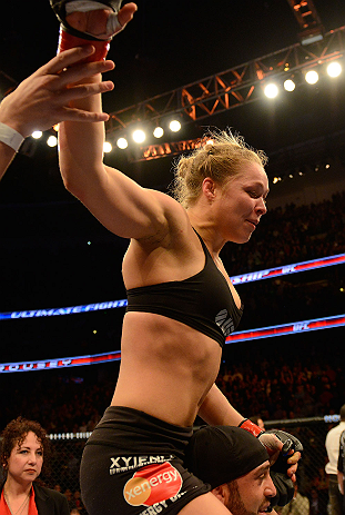 ANAHEIM, CA - FEBRUARY 23:  Ronda Rousey celebrates her victory over Liz Carmouche in their women's bantamweight title fight during UFC 157 at Honda Center on February 23, 2013 in Anaheim, California.  (Photo by Donald Miralle/Zuffa LLC/Zuffa LLC via Gett