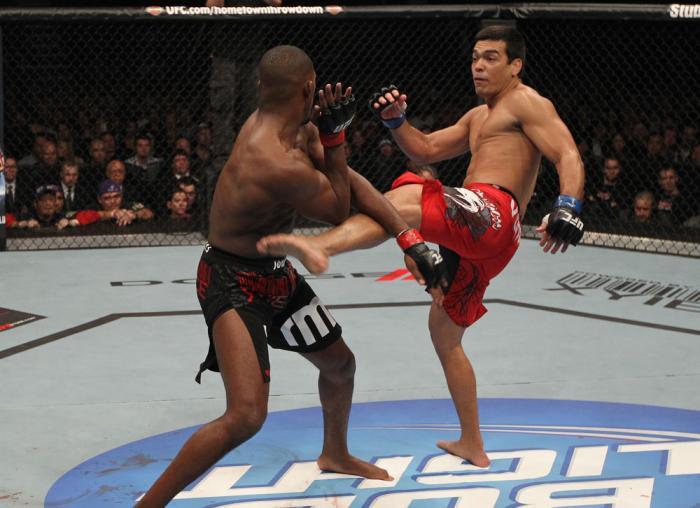 "TORONTO, ON - DECEMBER 10:  (R-L) Lyoto Machida kicks Jon ""Bones"" Jones during the UFC 140 event at Air Canada Centre on December 10, 2011 in Toronto, Ontario, Canada.  (Photo by Nick Laham/Zuffa LLC/Zuffa LLC via Getty Images)"
