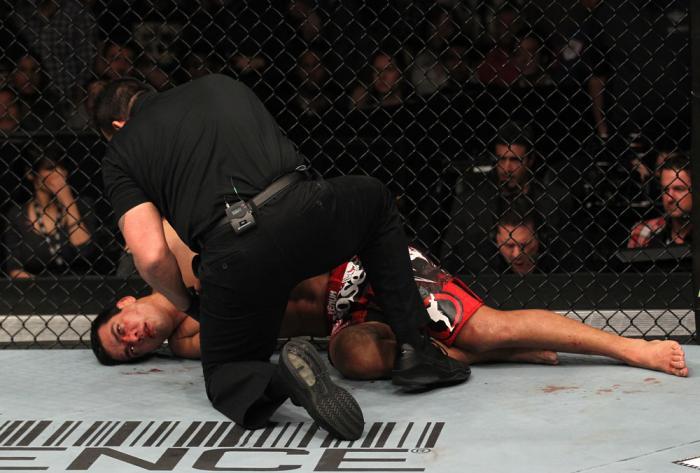 "TORONTO, ON - DECEMBER 10:  Lyoto Machida lies on the canvas unconscious after being defeated by Jon ""Bones"" Jones during the UFC 140 event at Air Canada Centre on December 10, 2011 in Toronto, Ontario, Canada.  (Photo by Nick Laham/Zuffa LLC/Zuffa LLC vi"