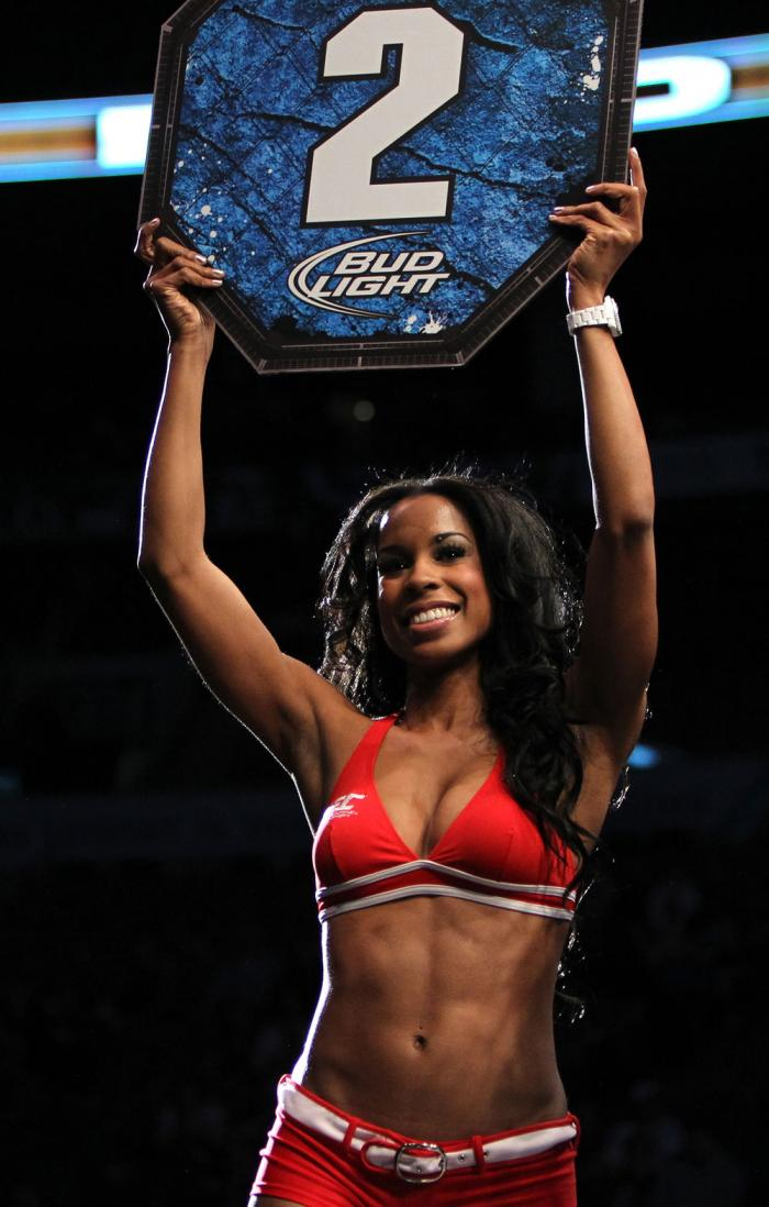 TORONTO, ON - DECEMBER 10:  UFC Octagon Girl Chandella Powell introduces round two during the Cholish v Clarke bout during the UFC 140 event at Air Canada Centre on December 10, 2011 in Toronto, Ontario, Canada.  (Photo by Josh Hedges/Zuffa LLC/Zuffa LLC