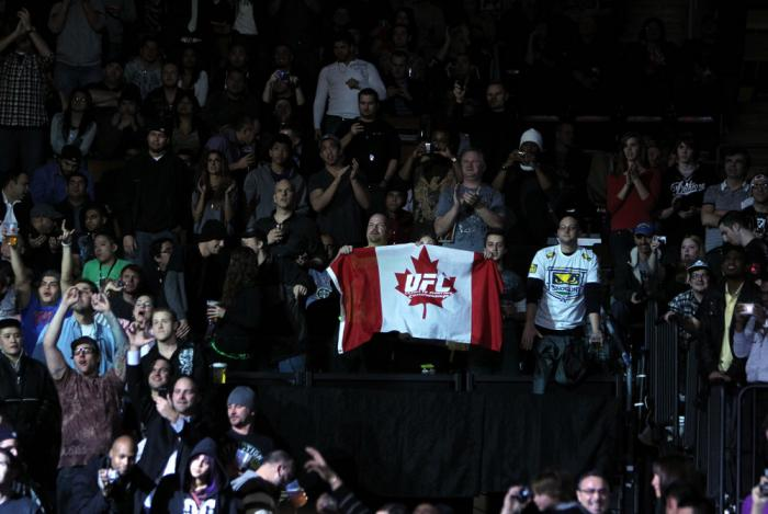 TORONTO, ON - DECEMBER 10:  A fan waves a UFC Canadian flag during the UFC 140 event at Air Canada Centre on December 10, 2011 in Toronto, Ontario, Canada.  (Photo by Josh Hedges/Zuffa LLC/Zuffa LLC via Getty Images)