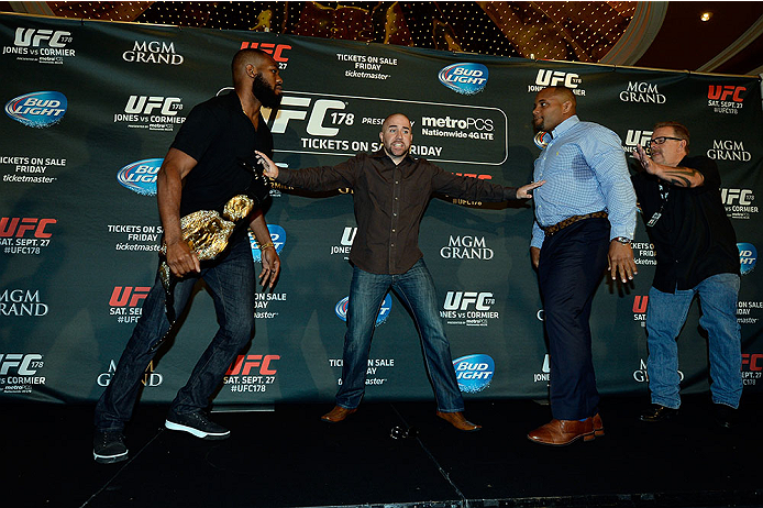 LAS VEGAS, NV - AUG 4:  (L-R) UFC light heavyweight champion Jon Jones and challenger Daniel Cormier are separated after facing off during the UFC 178 Ultimate Media Day at the MGM Grand Hotel/Casino on August 4, 2014 in Las Vegas, Nevada. (Photo by Jeff