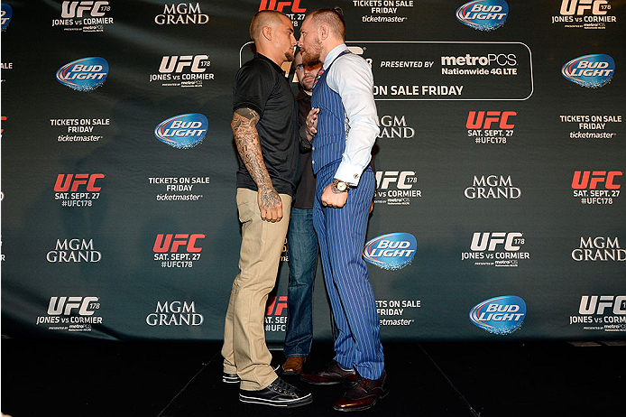 LAS VEGAS, NV - AUGUST 4:  (L-R) Dustin Poirier and Conor McGregor face off during the UFC 178 Ultimate Media Day at the MGM Grand Hotel/Casino on August 4, 2014 in Las Vegas, Nevada. (Photo by Jeff Bottari/Zuffa LLC/Zuffa LLC via Getty Images)