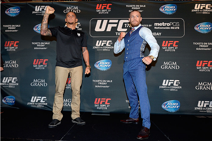LAS VEGAS, NV - AUGUST 4:  (L-R) Dustin Poirier and Conor McGregor pose for the crowd during the UFC 178 Ultimate Media Day at the MGM Grand Hotel/Casino on August 4, 2014 in Las Vegas, Nevada. (Photo by Jeff Bottari/Zuffa LLC/Zuffa LLC via Getty Images)