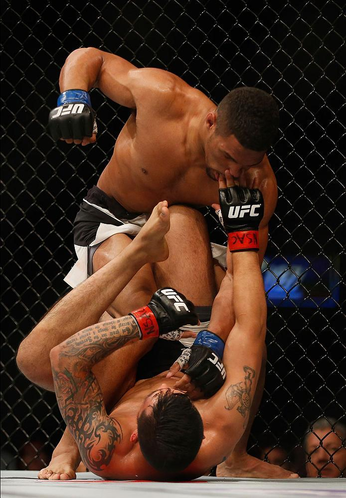 LAS VEGAS, NV - APRIL 23:  Kevin Lee (top) punches Efrain Escudero of Mexico in their lightweight bout during the UFC 197 event inside MGM Grand Garden Arena on April 23, 2016 in Las Vegas, Nevada.  (Photo by Christian Petersen/Zuffa LLC/Zuffa LLC via Get